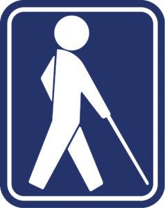 hvid mand med stok på blå baggrund